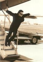 Bono jumping from plane